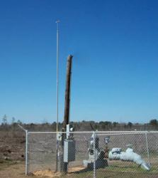 LBAs PLP-22 lightning mast protecting a Crossett Water well pump