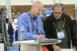 Researchers, suppliers, and end users meet in the SPIE DSS exhibition to share ideas and develop solutions.