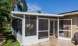 A patio screen enclosure from Venetian Builders, Inc., Miami. This room is designed to convert affordably to a sun room when a homeowner's budget allows.