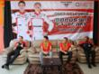 QNET officials and the Marussia F1 Team Drivers at a press conference after the event