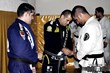 Sergio Silva receiving his third stripe from Master Leonardo Vieira