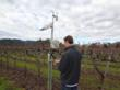 Paul Goldberg, vineyard manager, Bettinelli Vineyards, uses his smart phone to check weather station data from vineyards throughout Napa Valley.