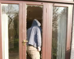 image of person breaking into home