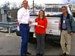 Curtis Donaldson, founder and CEO of CleanFUEL USA, presents ARRA funds to Ashley Williams, the City of Temple's Sustainability and Grant Manager, and Sam Weed, Superintendent of Fleet Services.