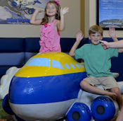 Children at Detroit Metropolitan Airport burn off energy in the new soft playground.