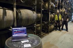 Otto Hermelin and Adam Hannett in a warehouse Bruichladdich