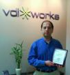 """VDIworks CEO, Amir Husain, holding the SBCA Best of Business award"""