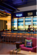 The w xyz ℠ bar with live music, DJs and events, overlooks a large, landscaped heated swimming pool