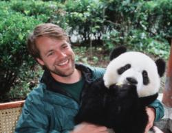 Volunteer Holding A Panda