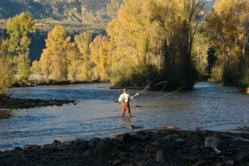 An early morning fly fisherman tests the waters at Rainbow Trout Ranch