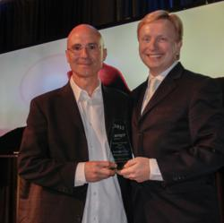 Greg Salloum, owner of BEST WESTERN PLUS Kelowna Hotel & Suites (left), receiving TOTA award from TOTA CEO, Glenn Mandziuk (right)