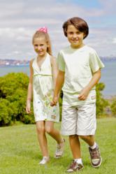 Tween boy and girl wearing Dhana EcoKids sustainable fashions