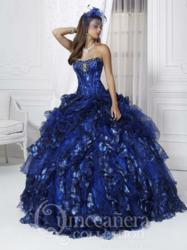 26717: Spring 2013 Quinceañera dress with scoop neckline, featuring full skirt with rosette and cascading ruffles.