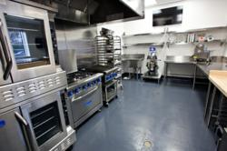 Kitchen FIVE is ideal for baking, with brand new cook lines, reach-in refrigerator, maple top table, shelves for day use and separate prep sinks. This kitchen is also outfitted to accommodate demonstration cooking classes, filming, or small team-building