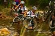 Andy Ording and Todd Winget wading through a river during the Cape Epic race