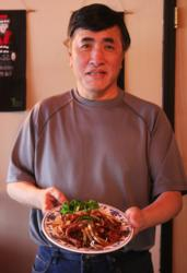 Peter Young with the Jade Gazebo in Oakhurst showcases one of his most popular dishes, an authentic Mongolian Beef, which has earned praise for it's bold and spicey flavor.