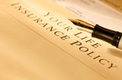 Photograph of life insurance policy with pen
