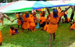 Children dancing in Tanzania on Wilderness Ventures teen summer camp.