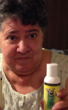 """Woman holding bottle of IPF-Pain Relief Lotion says """"'It stops the hurting'"""""""