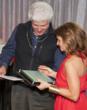 Architect Adolfo Perez receiving award from Clarke's Debra Burke