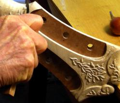 Robert Benedetto hand carves the headstock of his 45th Anniversary guitar, April 2013