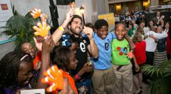 education everytime founder celebrates with students.