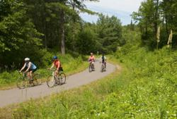 Minnesota's 110 mile Paul Bunyan Trail  runs from Brainerd MN to Bemidji offering biking, geocaching, and more.