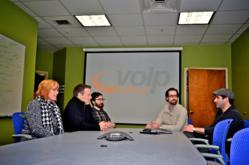 PJ Tudisco (far right), Project Manager of VoIP Supply, relies on clear communication to keep teams on task.