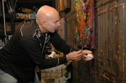 Artist JD Miller alters his painting on the studio wall