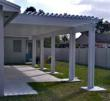 A combination insulated, solid roof panel and pergola installed by Venetian Builders, Inc., Miami.