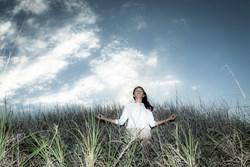 image of a woman meditating at the beach