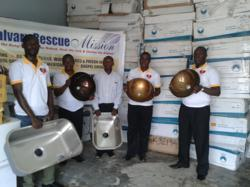 Rev. George Abaidoo, Founder and Executive Director of CRM (on the far right) is joined by Calvary Rescue Mission Representatives, as they pose with the VIGO Kitchen Sinks & Bathroom Vessel Sinks.