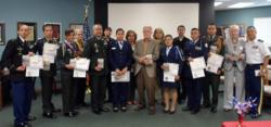 Competition finalists with judges and Major General Charles Rodriguez