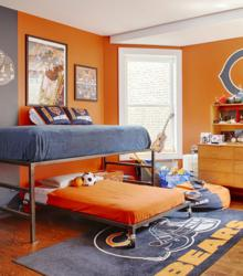 This Chicago Bears themed room features sports posters and team colors with coordinating linens, rugs and memorabilia. Sports posters like the ones shown are available from SportsPosterWarehouse.com