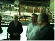 Photo: (L-R) Aeros VP Frederick Edworthy, Ambassador Elin Syleymanov, and Congressman Rohrabacher talk inside the vehicle structure
