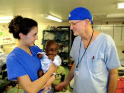 Carys Parker, 18 (left) with her father Dr. Gary Parker (right) on board the Africa Mercy.