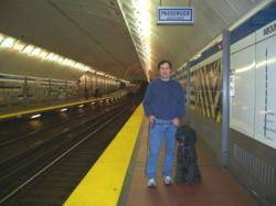 Len Kain and Dog Toby on the Boston T Subway Platform