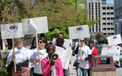 photo of demonstrators marching to prevent childhood sexual molestation