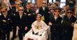 Everest Kindergarten student Nathaniel Akroush of Lemont, celebrates Pope Day with his bodyguards.