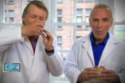 Drs. Sinatra (L) and Bowden (R) eating hamburgers to show cholesterol is good for you.