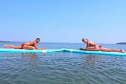 Gina Bradley of Paddle Diva (right) and Jessica Bellofatto of Kama Deva Yoga