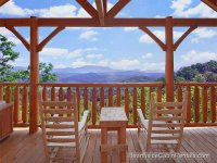 Gatlinburg cabins in the Smoky Mountains Tennessee from a porch on wooden rocking chairs.