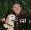 Retired Marine Michael Jernigan in full decorative uniform, with guide dog Brittani