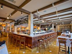Manufactured wood beams create a consistent appearance for commercial designs
