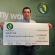 Our MD with the cheque ready to give it to Cash for Kids