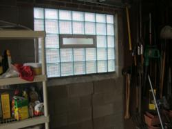 Glass block garage window to improve light energy efficiency & privacy