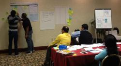 Students engaged in a case study exercise in a Scrum Master Certified class.