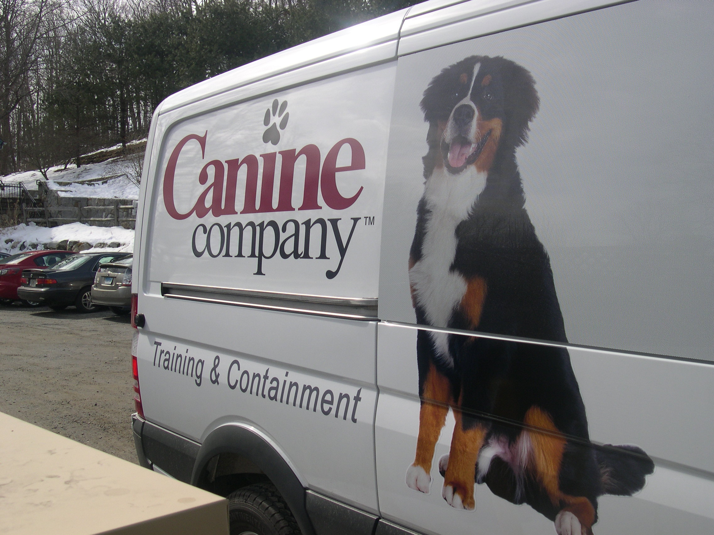 Canine Company Facilitates Rebranding With Car Decals From - Car window decals near meperforated car window decals signscom