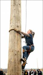 Alaina Bailey of Webster, New York climbs her way to a win in the women's pole climb event at the Northeast Collegiate Woodsmen Conclave held at FLCC.