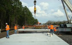 Workers installing precast concrete pavement panels in Florida.